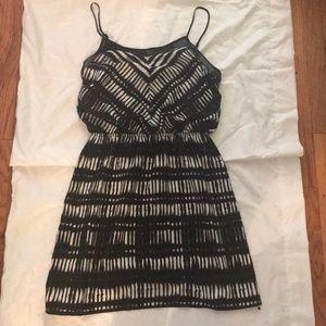 Express dress. Black and white, blouson style top